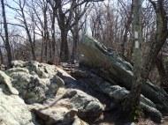 over boulders,